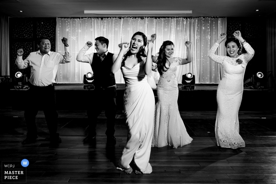 Wedding photo of bridal party on the dance floor at the Amiana Resort in Nha Trang