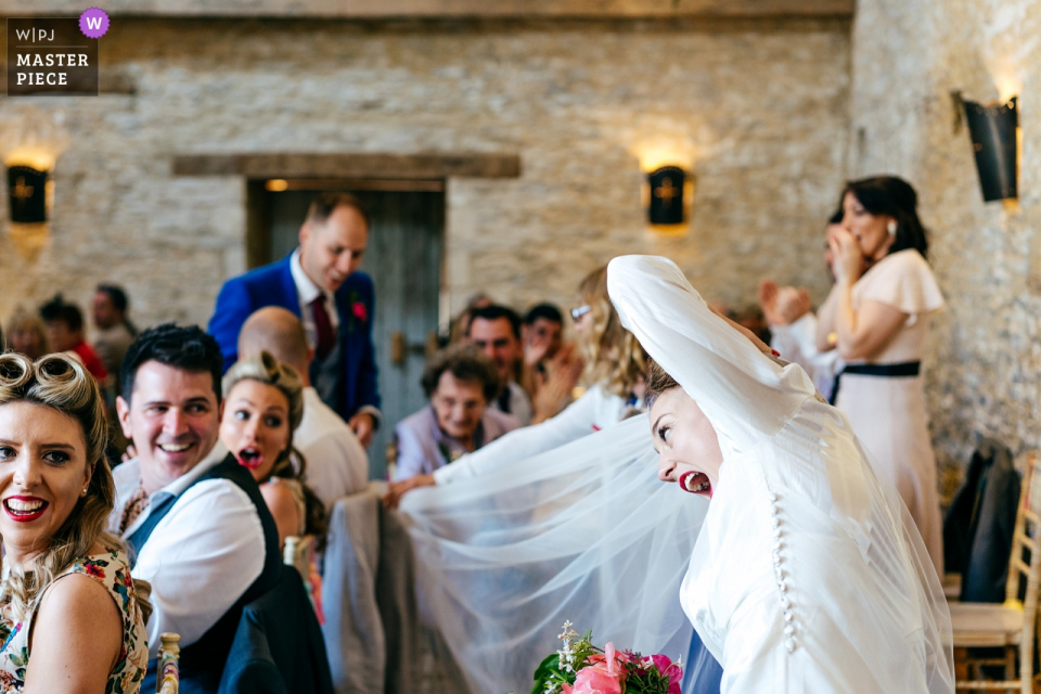 Oxleaze Barn Cotswolds Wedding Venue Photographer - As couple were announced in bride's veil guest caught on chair - much shock/laughter ensued...