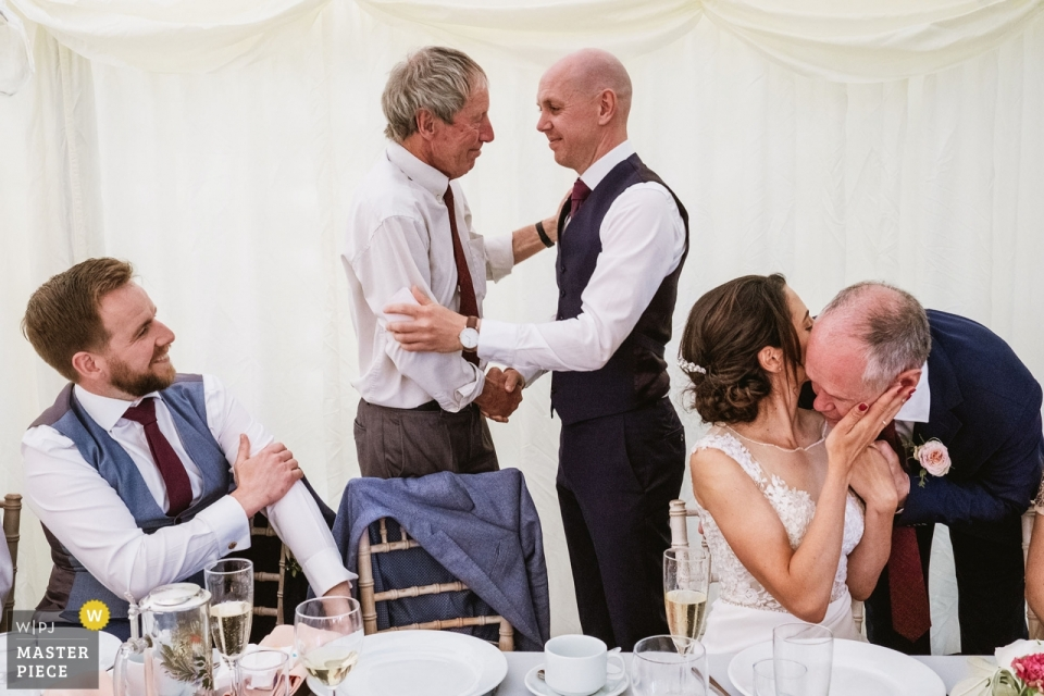 Leathley Village Hall Wedding Venue - Photography of Hugs After the speeches.