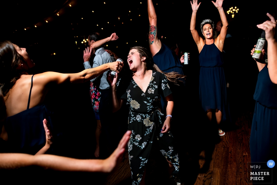Lionsgate Event Center Photos - Wedding guest singing into a beer can microphone.