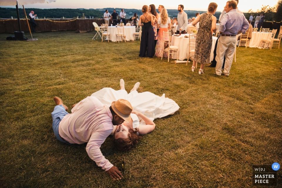 Calstelnau des Fieumarcon Wedding Photojournalism -  After the ceremony the couple kisse