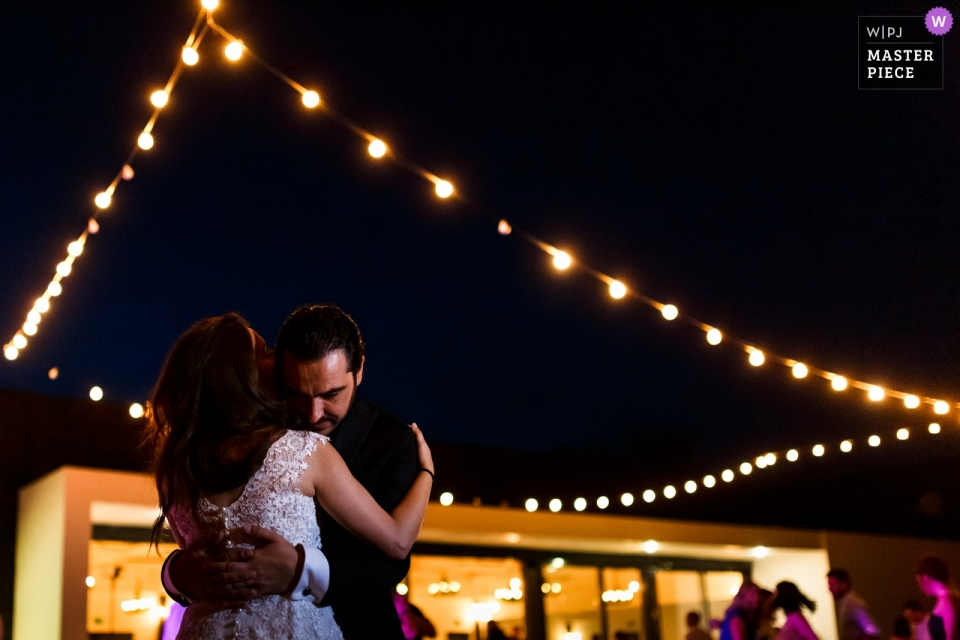 Tree House Cosoba Photography - Bride and groom dancing at the wedding reception