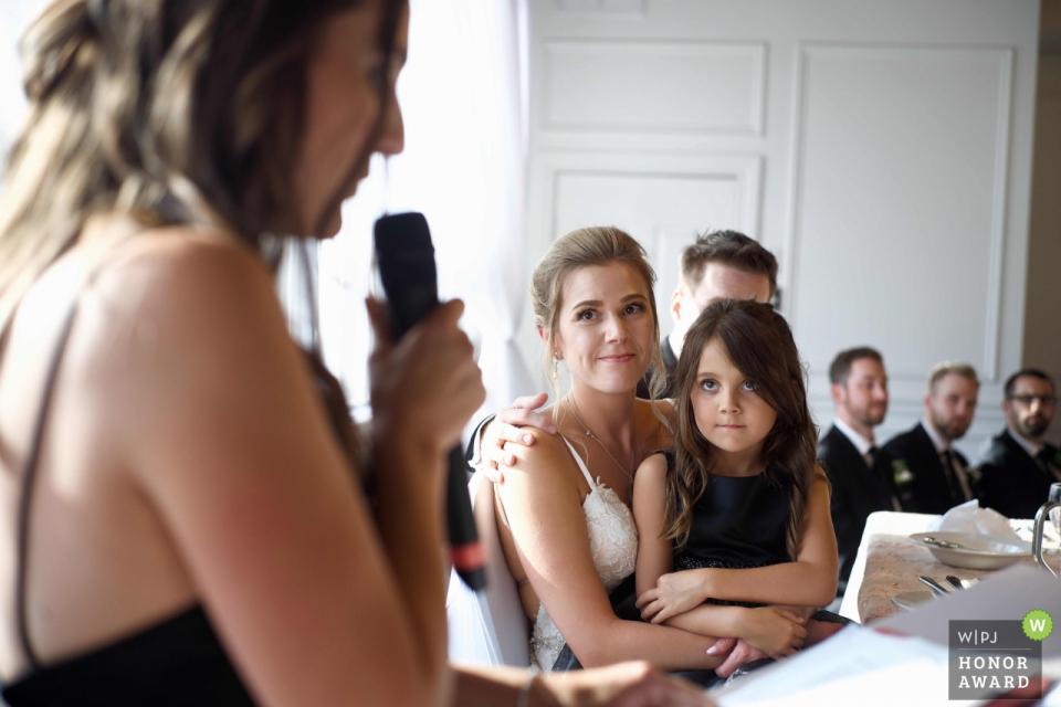 Kathi Robertson, of Ontario, is a wedding photographer for -