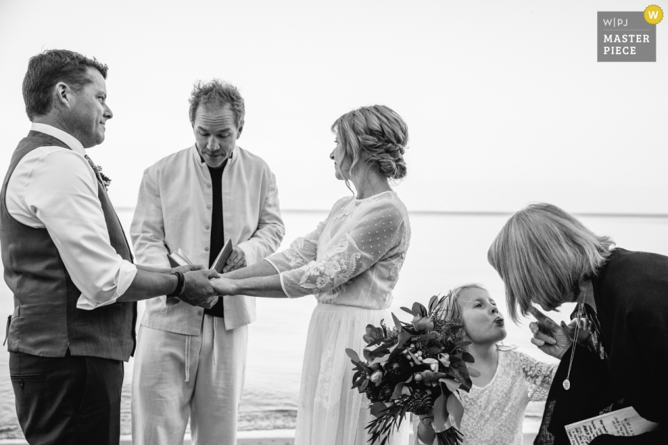 Sugar Pine Point State Park: Tahoma, CA wedding photography – The bride's daughter goofs off during her mother's ceremony.