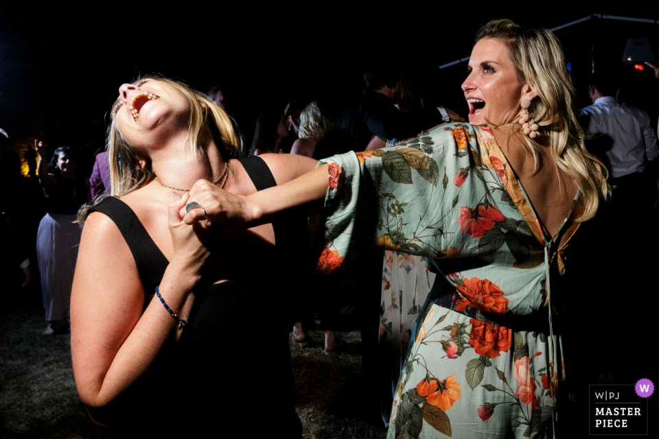 Chateau du Pin - Dance Floor Party! - Wedding photography of guests dancing at the reception