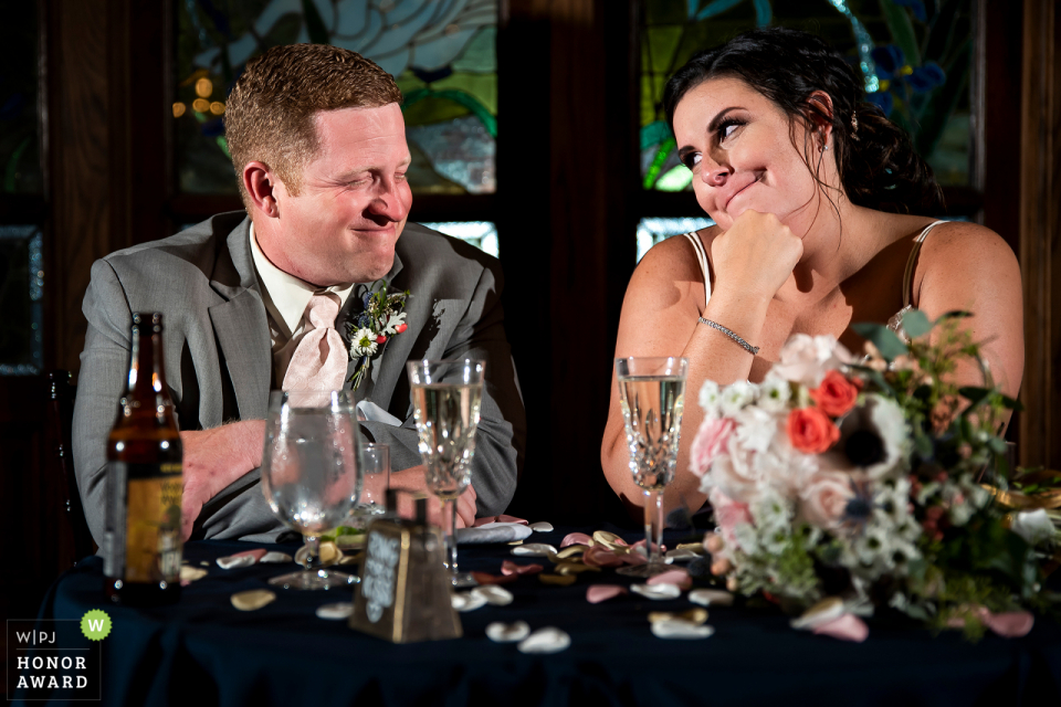 Lionsgate Event Center (Lafayette, CO) - Wedding Photojournalism at the Venue - Bride and groom sharing a glance during toasts.