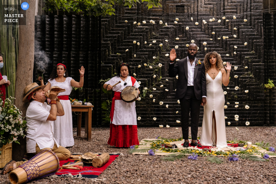 Hotel Azul, Oaxaca City outdoor marriage award-winning image showing a Zapotec ceremony moment. The world's best wedding photo contests presented by the WPJA