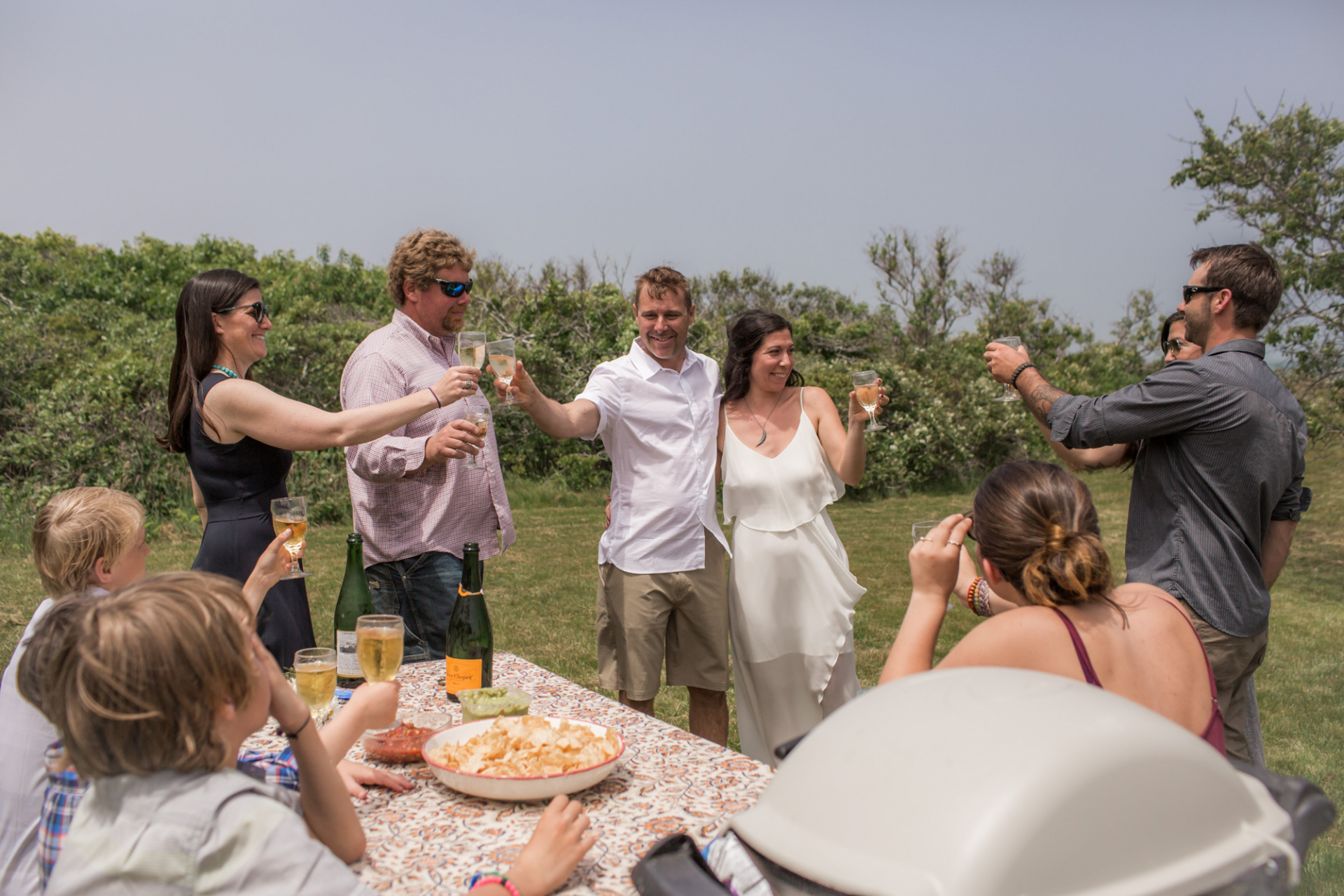 Cheers! A toast after the wedding ceremony on an Island, MA