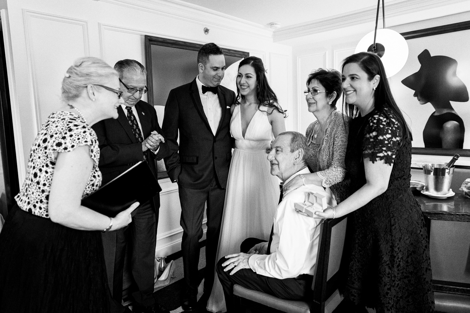 The bride father began to show signs of a stroke, so the officiant Rev. Annie Lawrence married the couple in a quick ceremony at the Ritz Carlton - Central Park