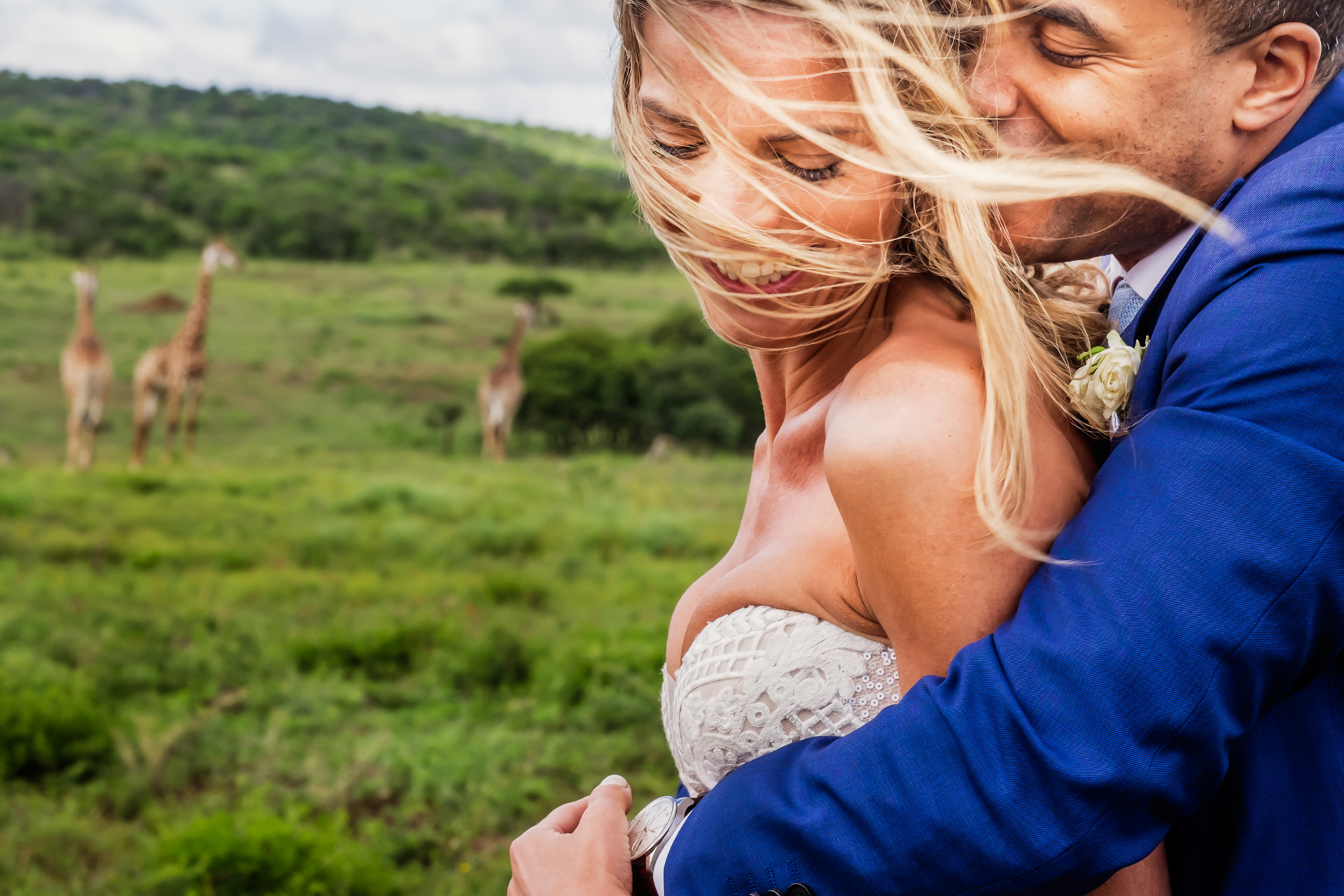 The stormy weather after the thunderstorm created beautiful moody weather for the couple's quick photo shoot in the African safari with wildlife in the background at Nambiti Hills, KwaZulu Natal Midlands, South Africa