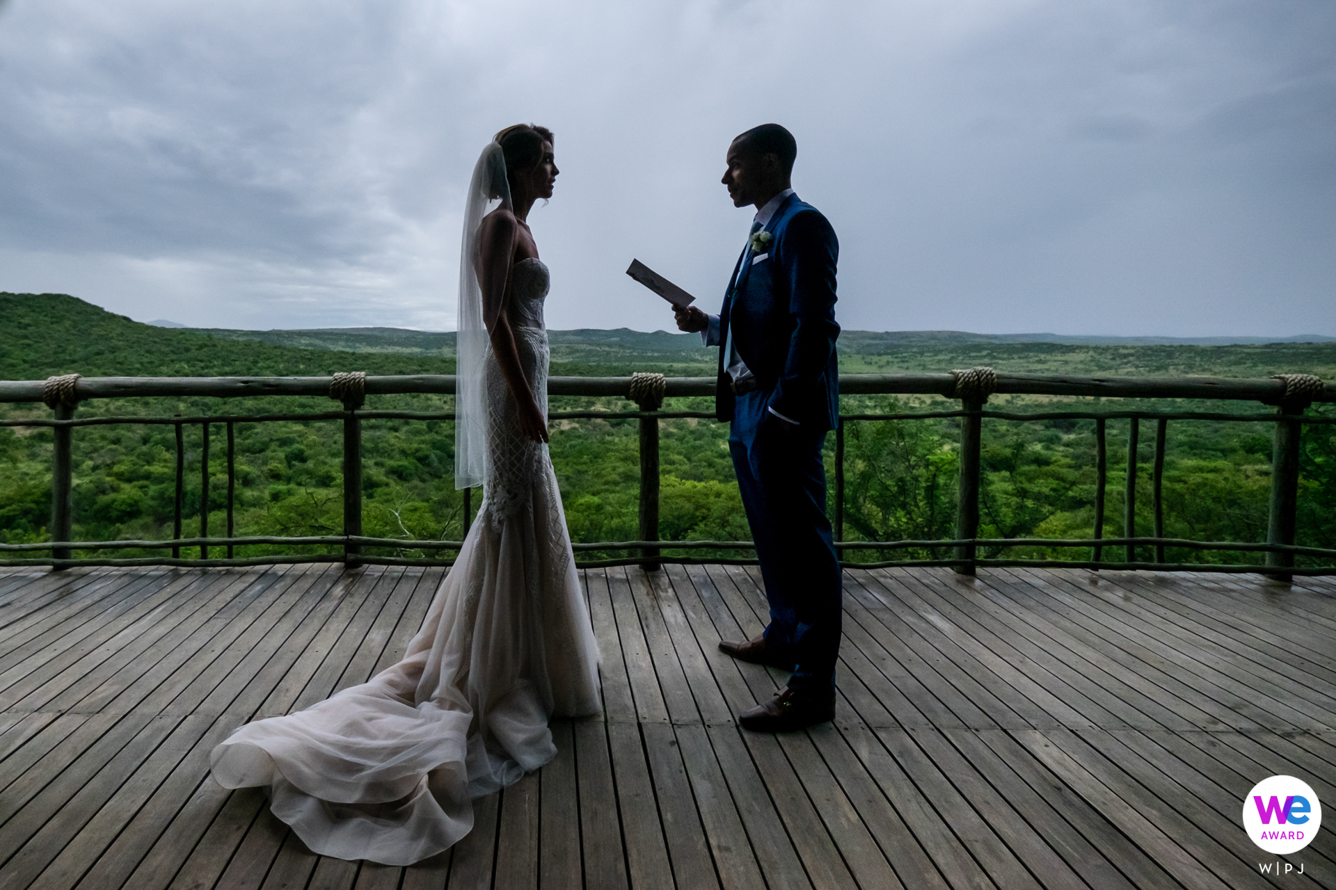 Nambiti Hills, KwaZulu Natal Midlands, South Africa Elopement Image - The couple exchanges private vows during their first look at their African elopement wedding with the vast African grasslands as the backdrop.