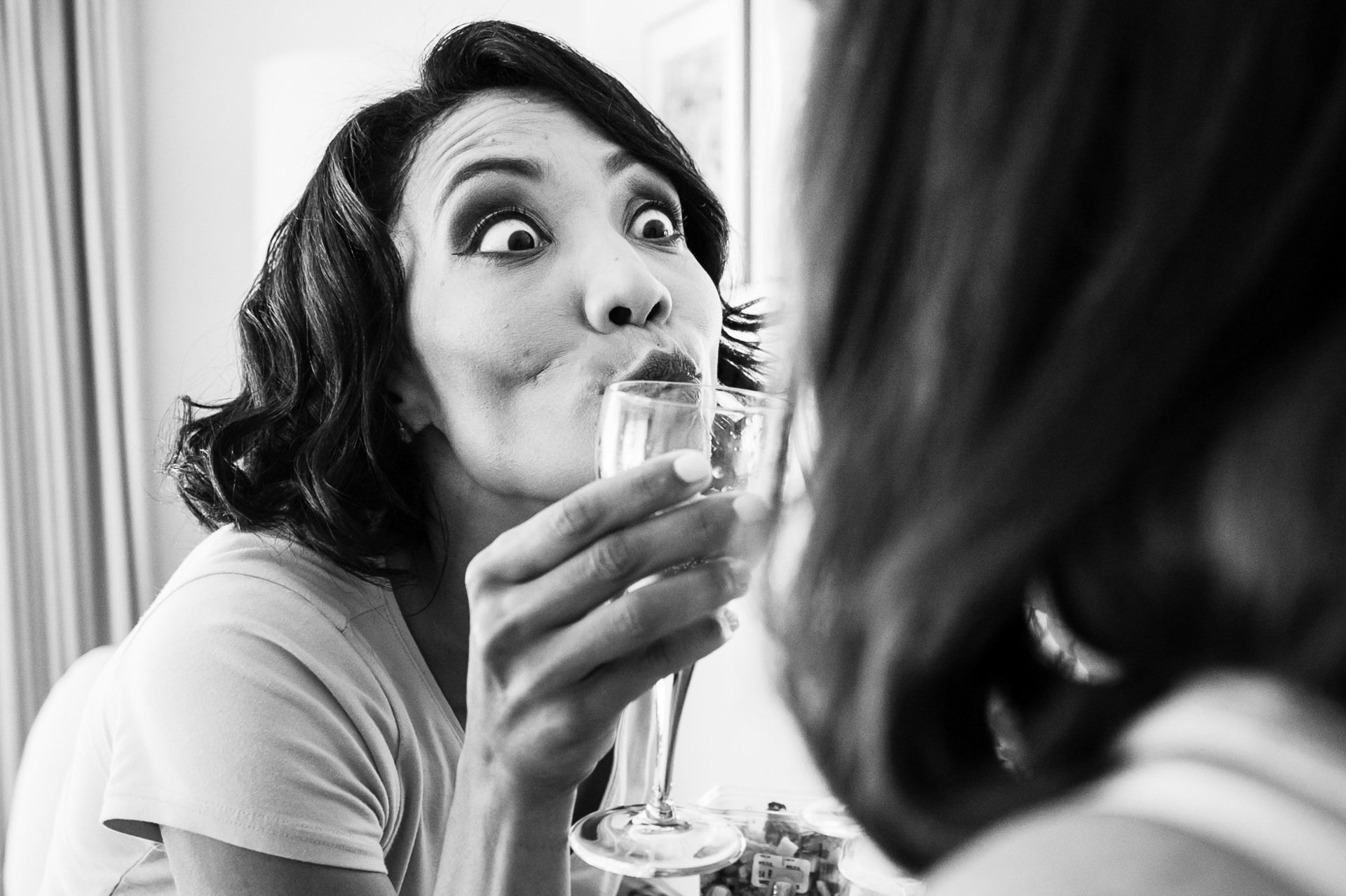 The bride making sure to get eye contact with her cheers to avoid a superstition. It created a very comical moment at this South Africa Elopement