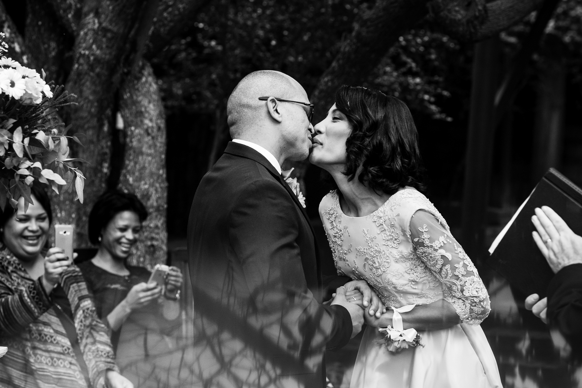 Wilderness, Garden Route, South Africa Elopement Image - Finally, the first kiss as husband and wife! I love the guests' reaction and the little peck the couple creates.