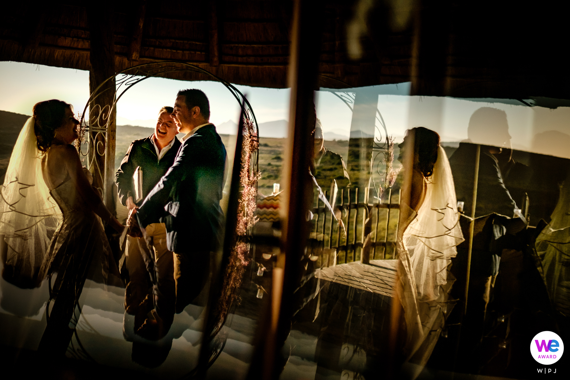 South Africa Destination Elopements - Photography from the ceremony - it was filled with these great reactions and I shot it creatively by using the stunning golden hour light with reflections.