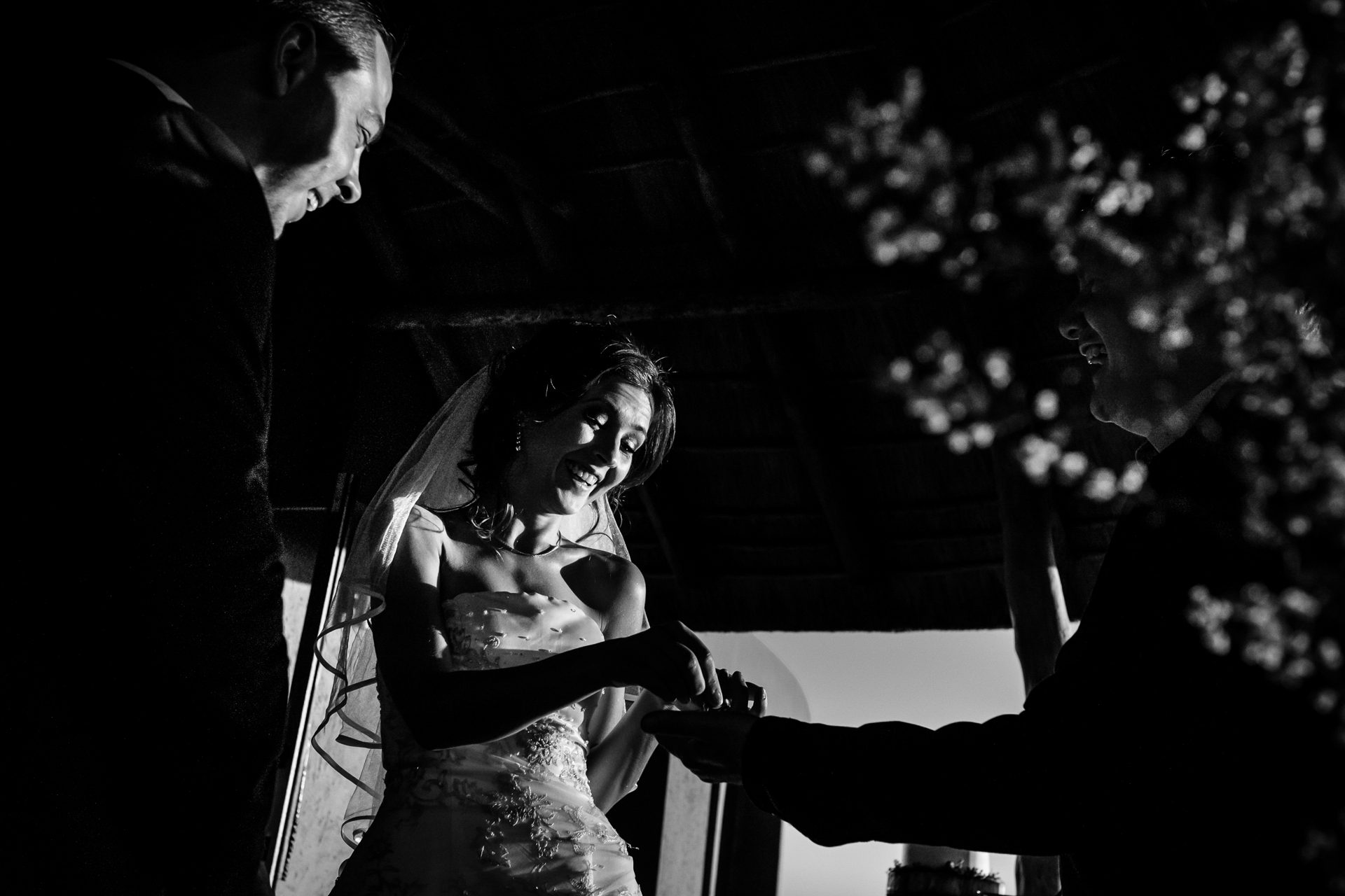 A funny moment when the bride took the wedding ring to place on the groom. I love the light and emotions in this image from a South Africa elopement ceremony.