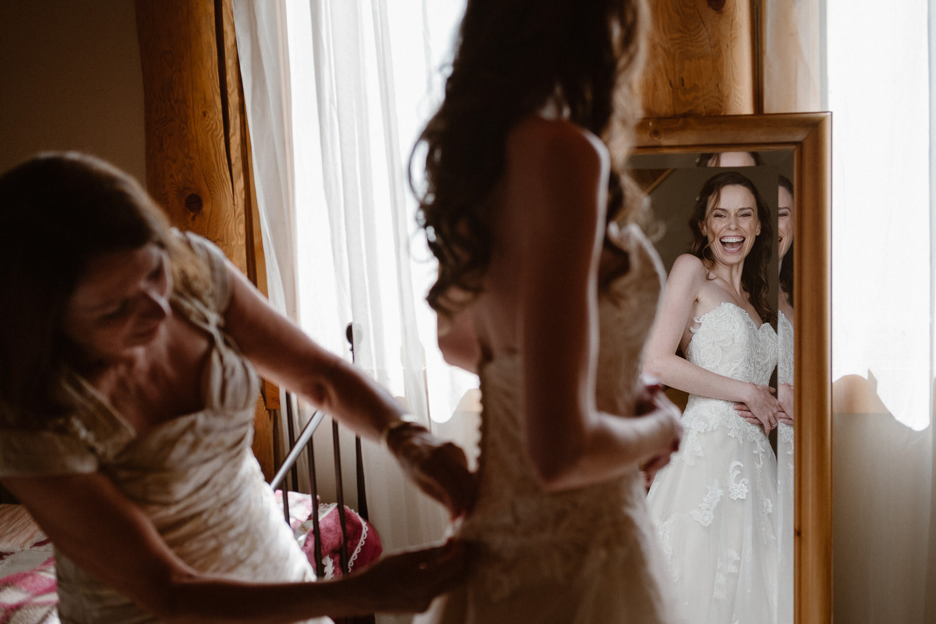 Bride getting ready with her mother at the groom's family cabin at Red Feather Lakes, CO