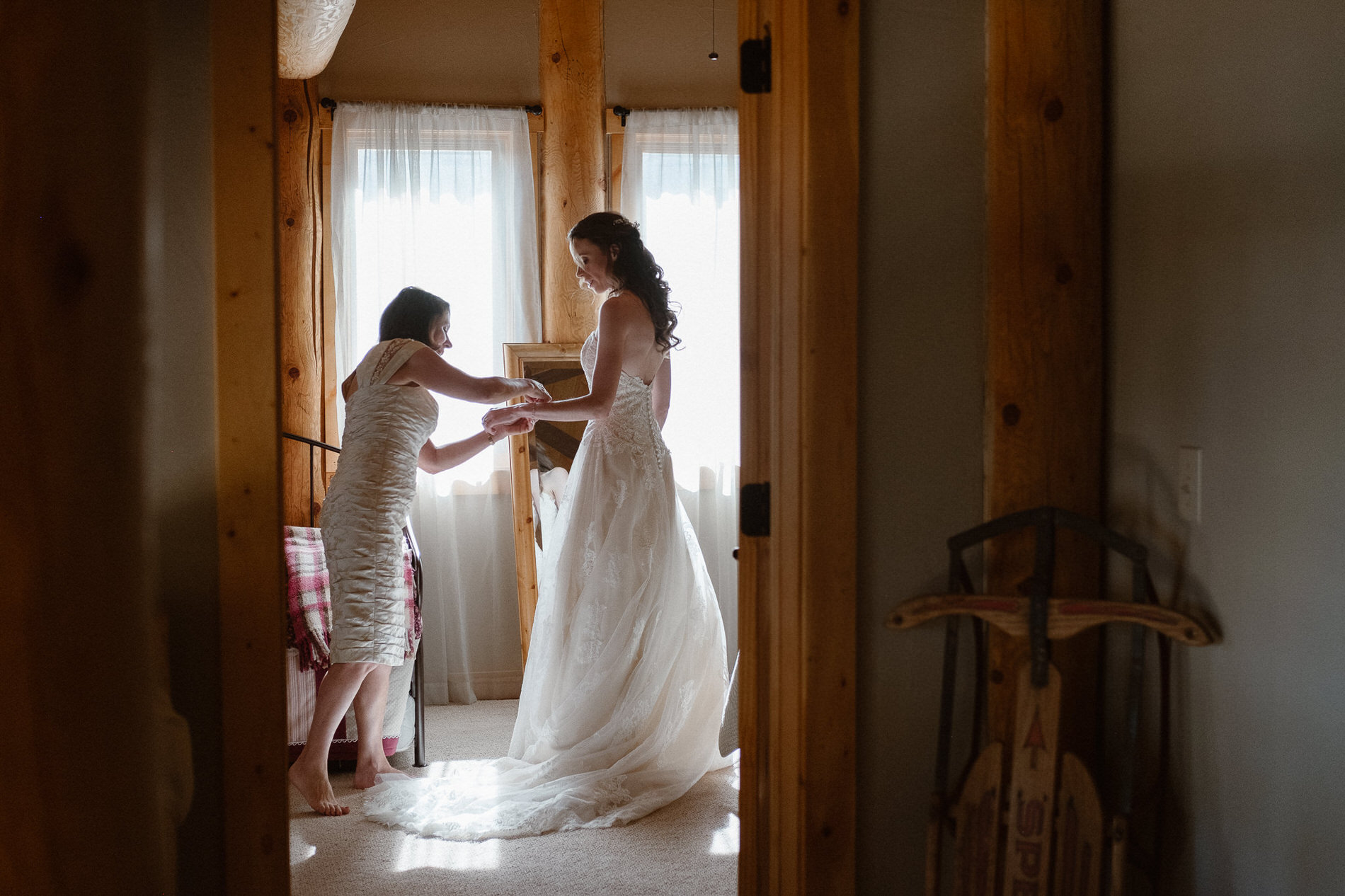 Bride getting ready with her mother before the elopement ceremony at Red Feather Lakes, CO