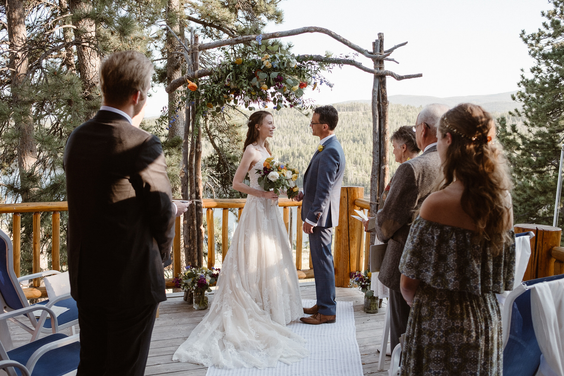Elopement ceremony at the groom's family cabin with only the closest family in attendance at Red Feather Lakes, CO