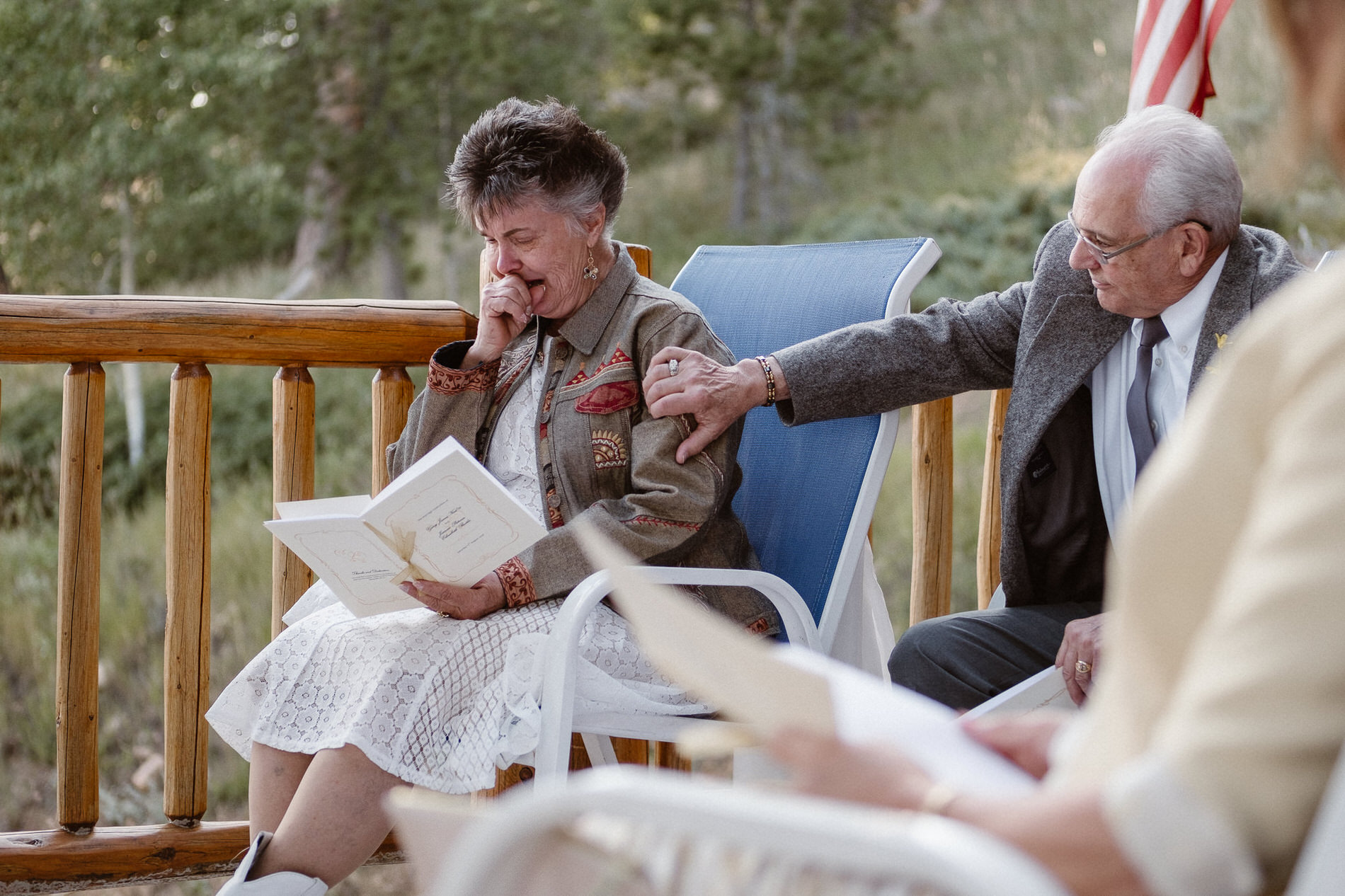 Groom's mother cries as she reads a poem during the elopement ceremony at Red Feather Lakes, CO