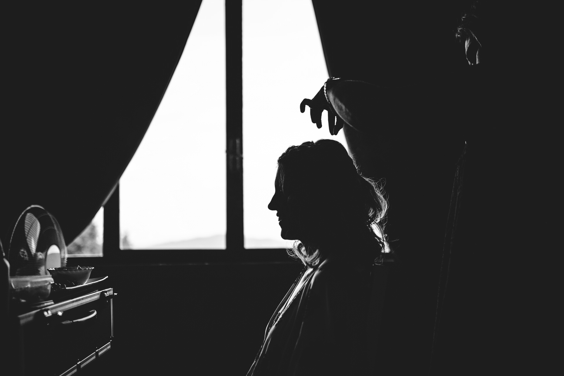 Silhouette during the getting ready for elopement ceremoy at Villa Olimpia, Ambra, Tuscany