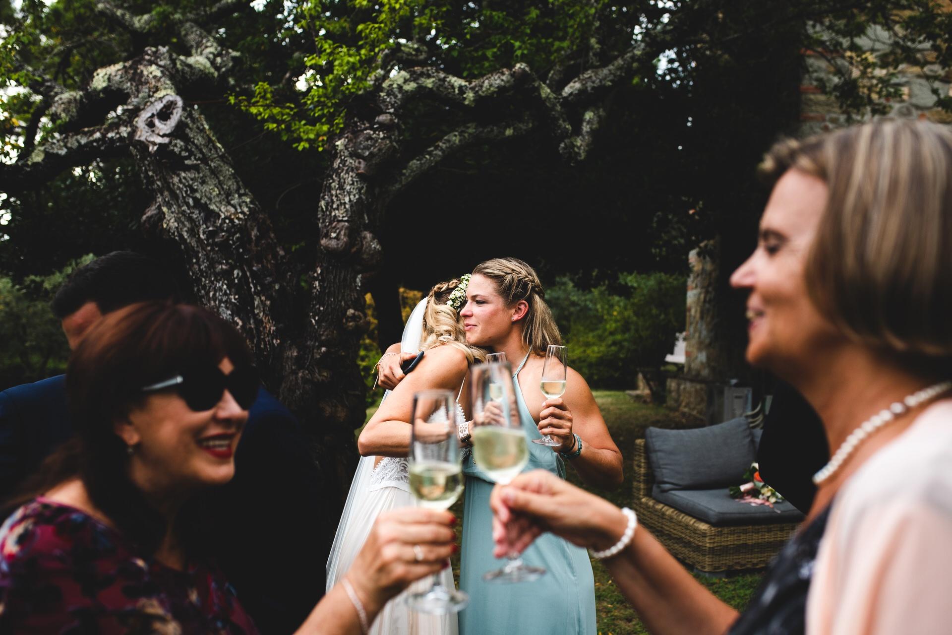 Cheers and hugs for the bride at Villa Olimpia, Ambra, Tuscany