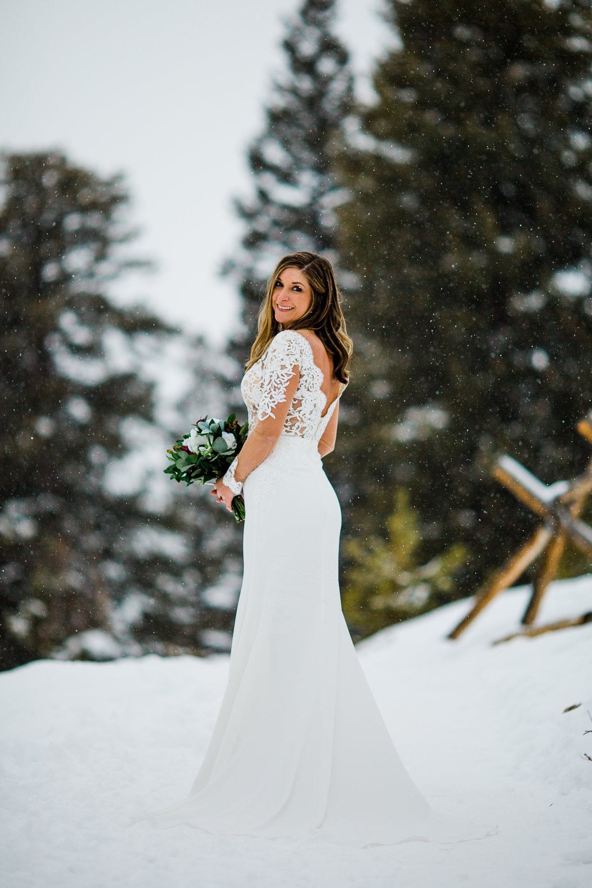 Vertical Winter Portrait of the bride after the ceremony at Sapphire Point Overlook Colorado