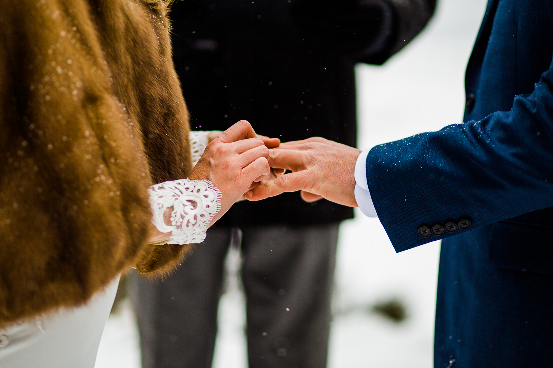 Detail image from elopement. The couple exchanging rings at Sapphire Point Overlook