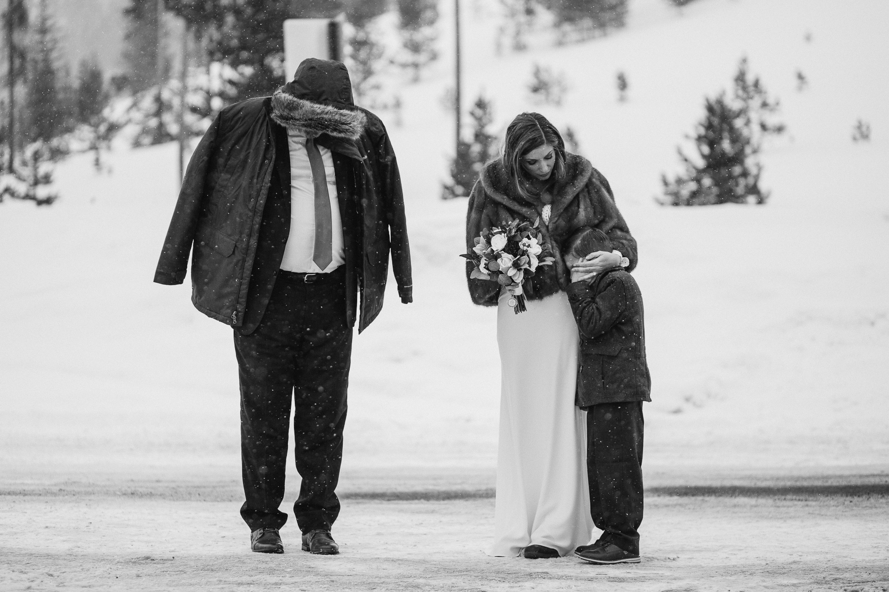 Bride waiting to walk down the aisle with her son and father at Sapphire Point Overlook Colorado