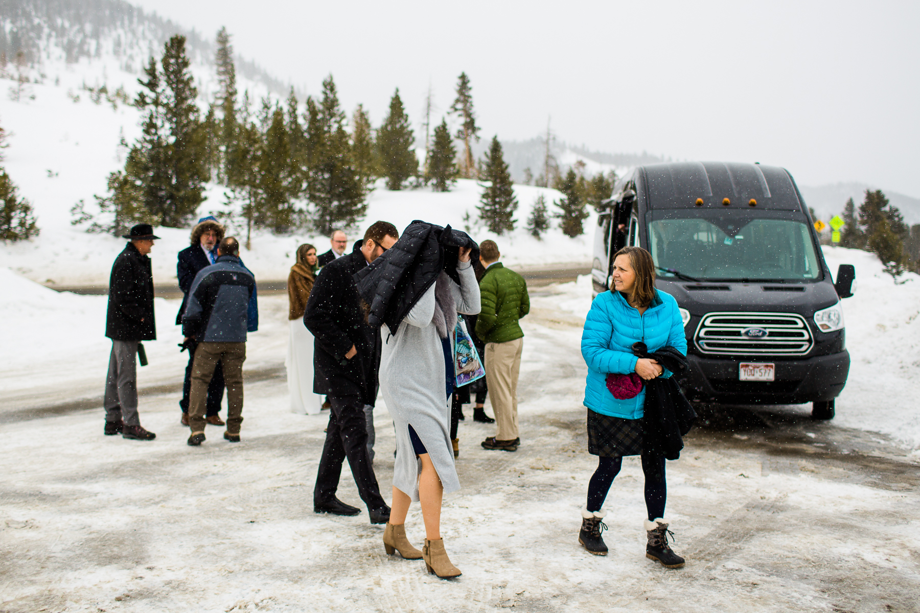 Family getting out of the shuttle at ceremony site at Sapphire Point Overlook Colorado