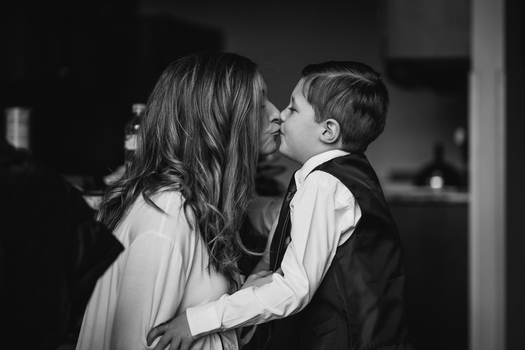 Bride kissing her son on the morning of the wedding at Beaver Run Resort in Breckenridge, CO