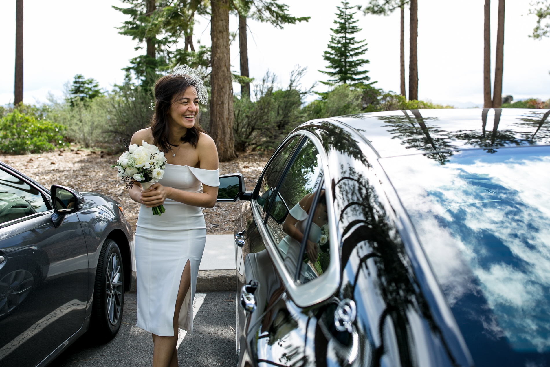 Sand Harbor State Park, Nevada Elopement Image - The bride gets out of the car and is nervous that her groom might see her before the ceremony.