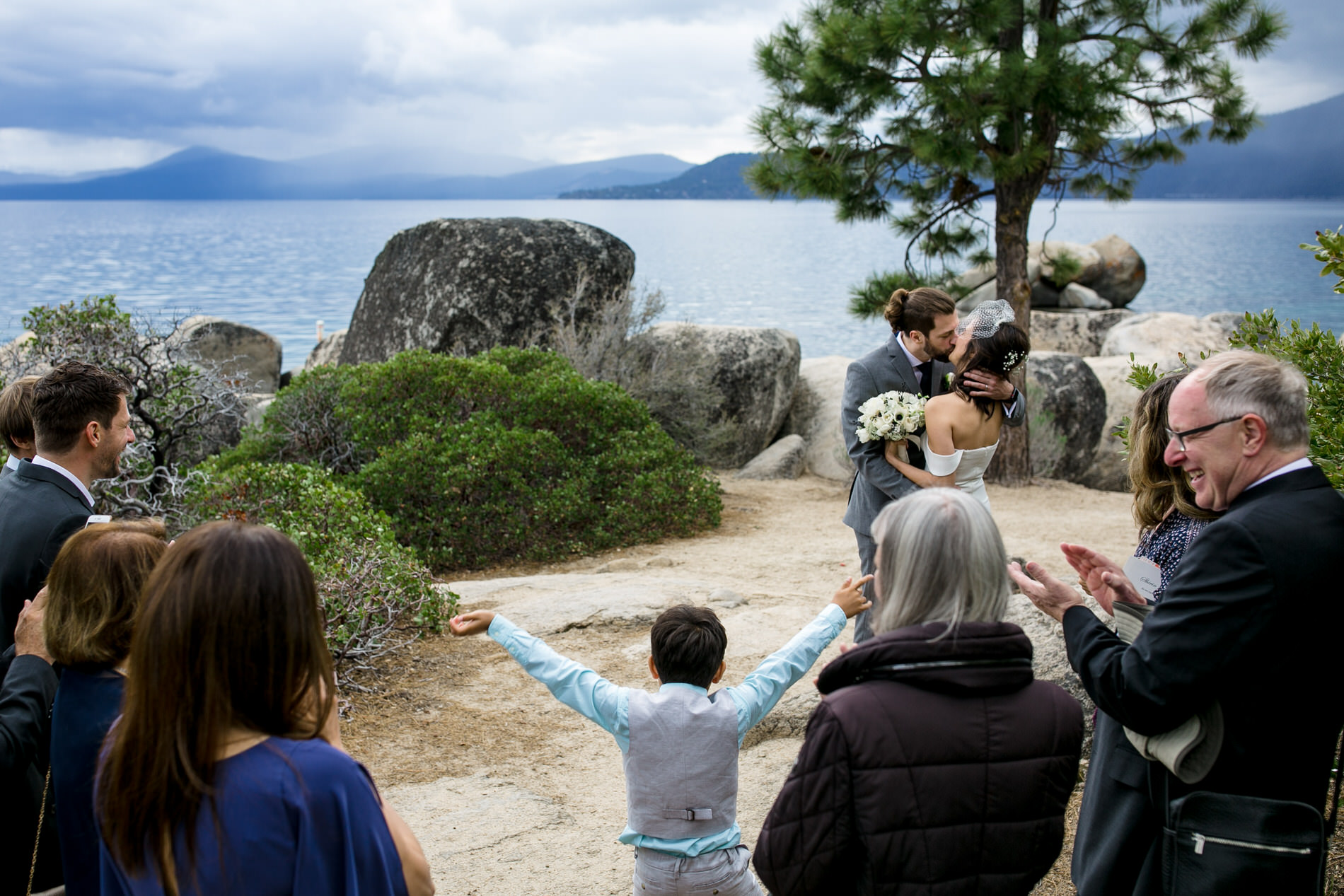 Sand Harbor State Park, Nevada Elopement Picture | First kiss as husband and wife on the shores of Lake Tahoe.
