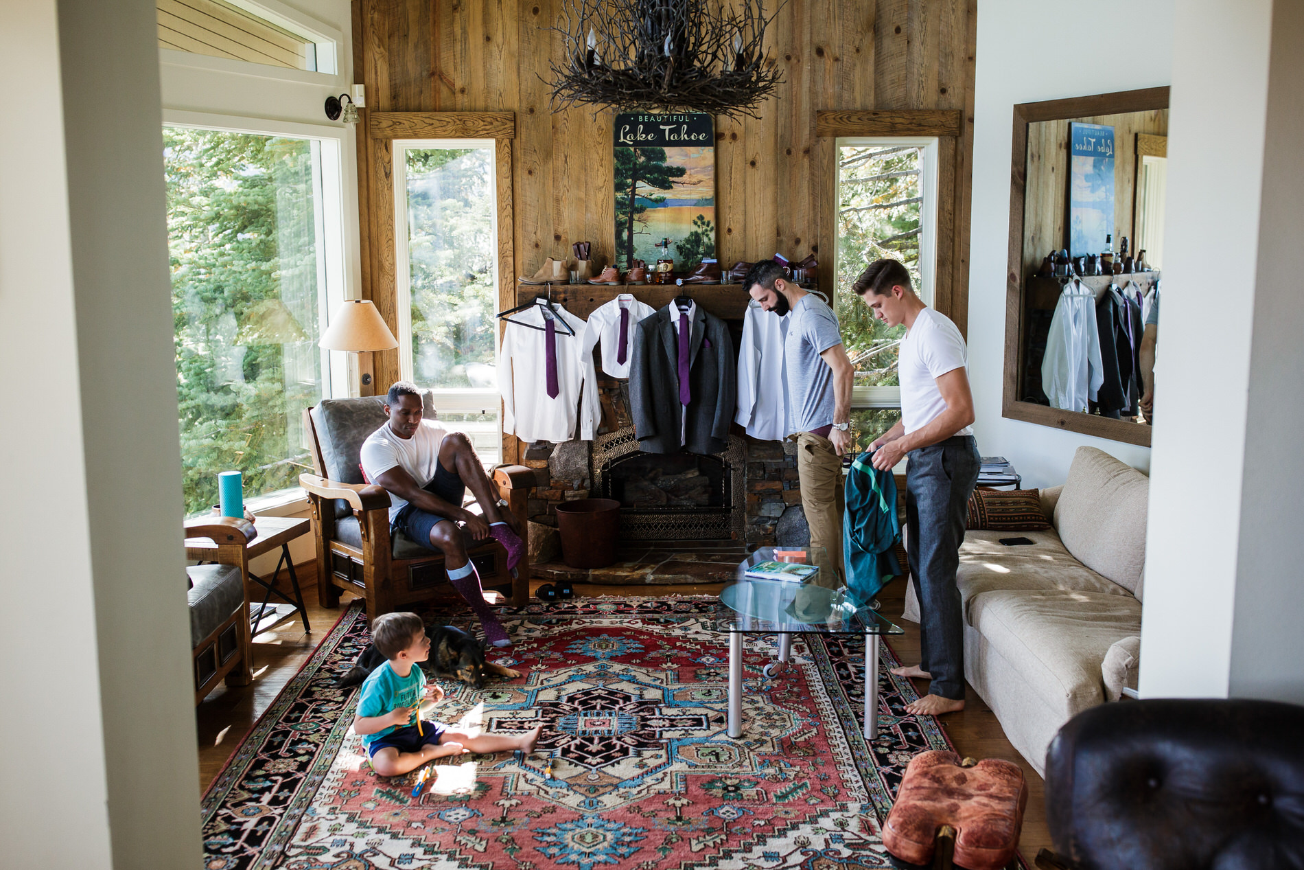 Tahoe City, California Elopement Picture | The groom, two friends, and the groom's son get dressed for their small wedding