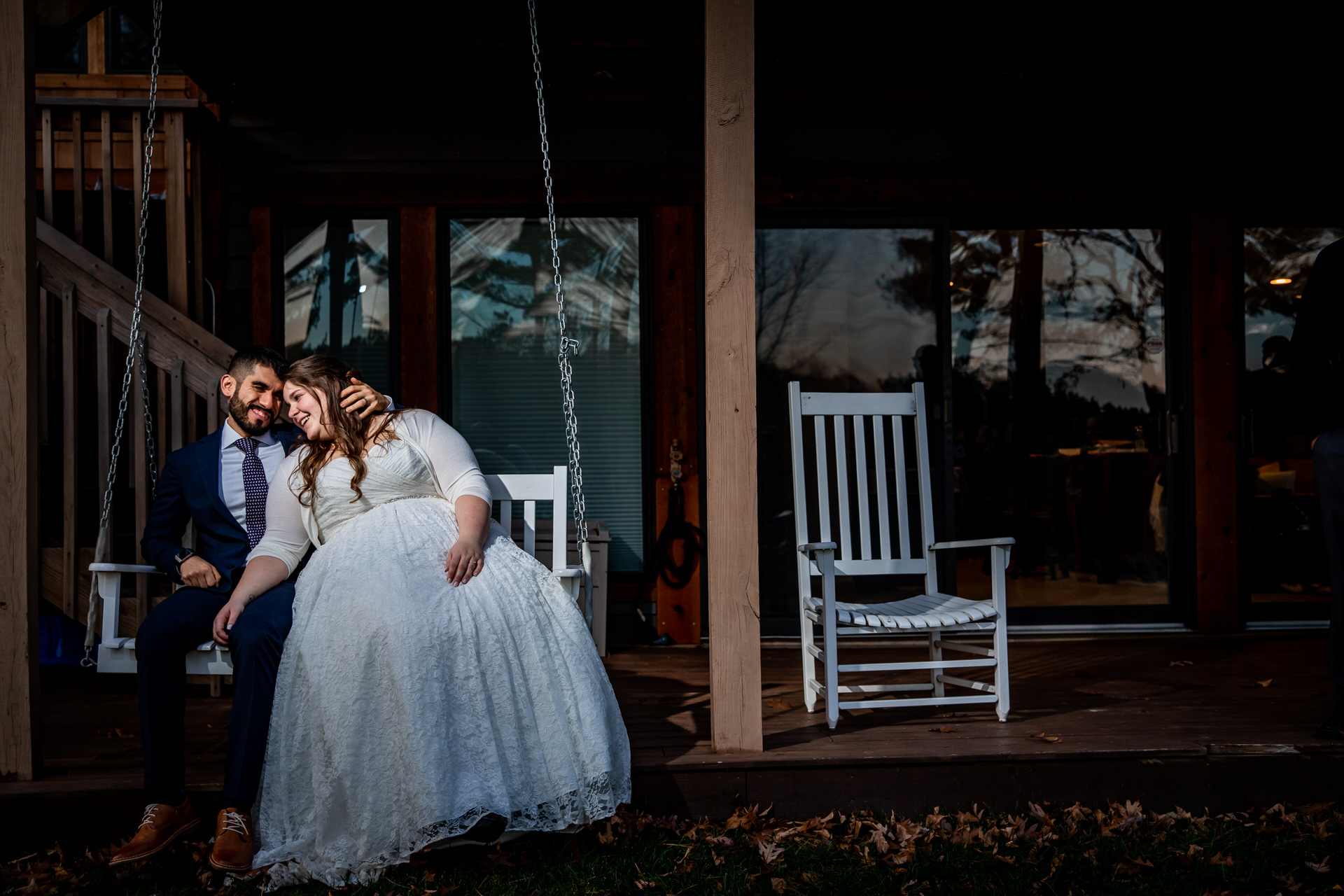 Elopement Portrait at Balsam Lake, Wisconsin   Couple sitting on a porch swing