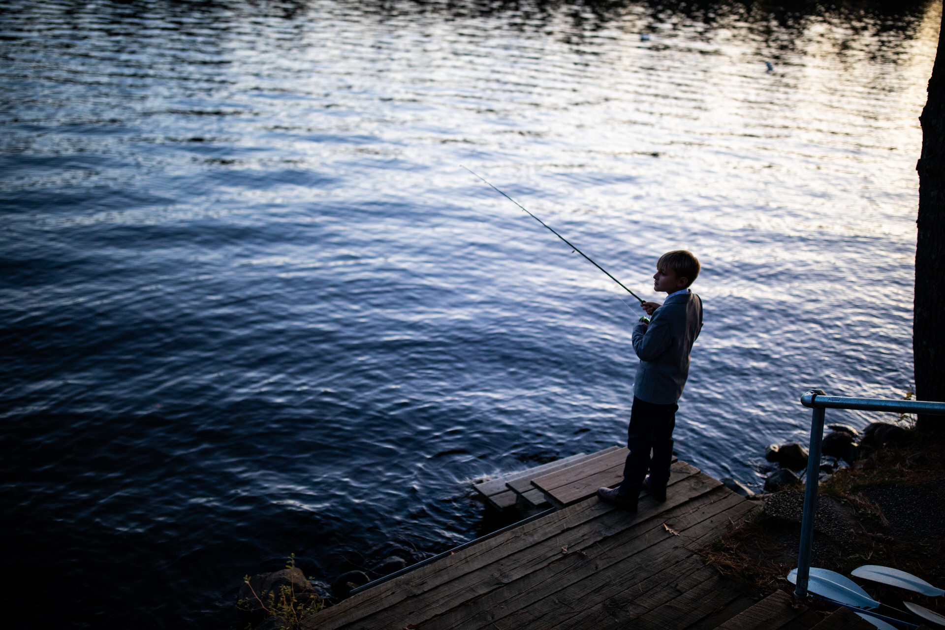 Elopement Reception Image from Balsam Lake, Wisconsin   A kid fishing on the lake.