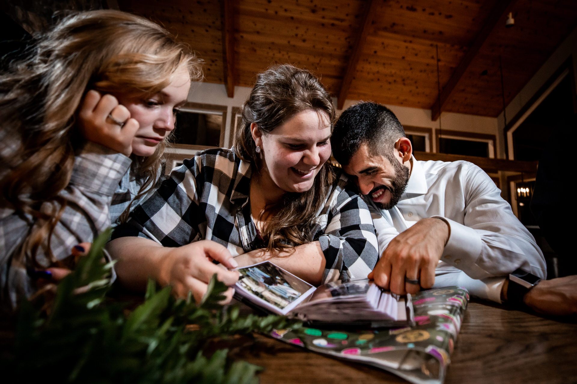 Balsam Lake, Wisconsin - The eloping couple is looking through an old family photo album.