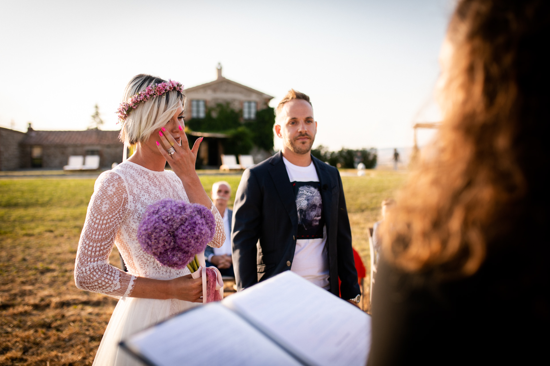 Tuscany IT, Elopement Wedding Image | The bride is crying at the beginning of the outdoor ceremony in the countryside.