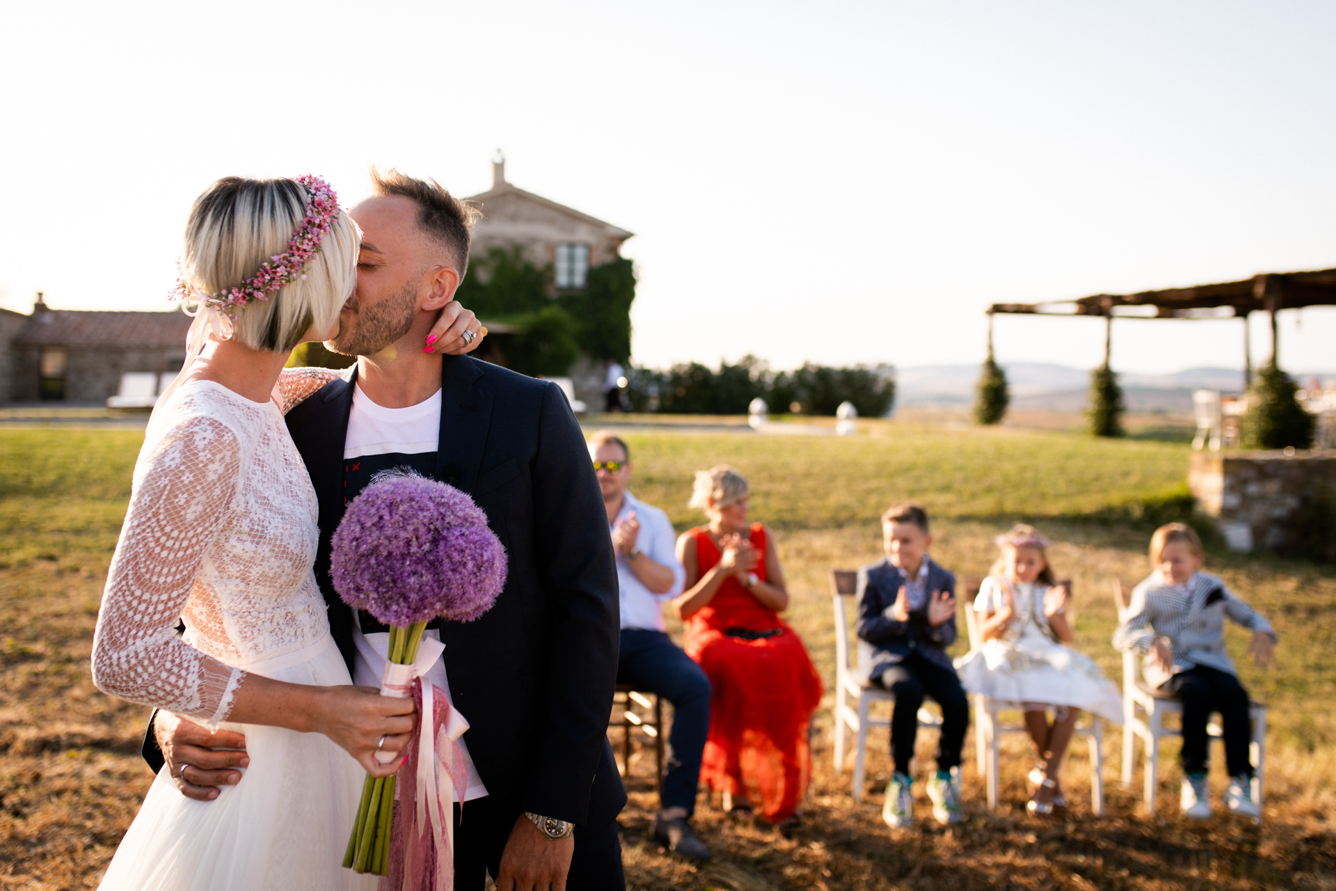 Italy Elopement Photography | The bride and groom's kiss at the end of the outdoor ceremony at the farmhouse venue.
