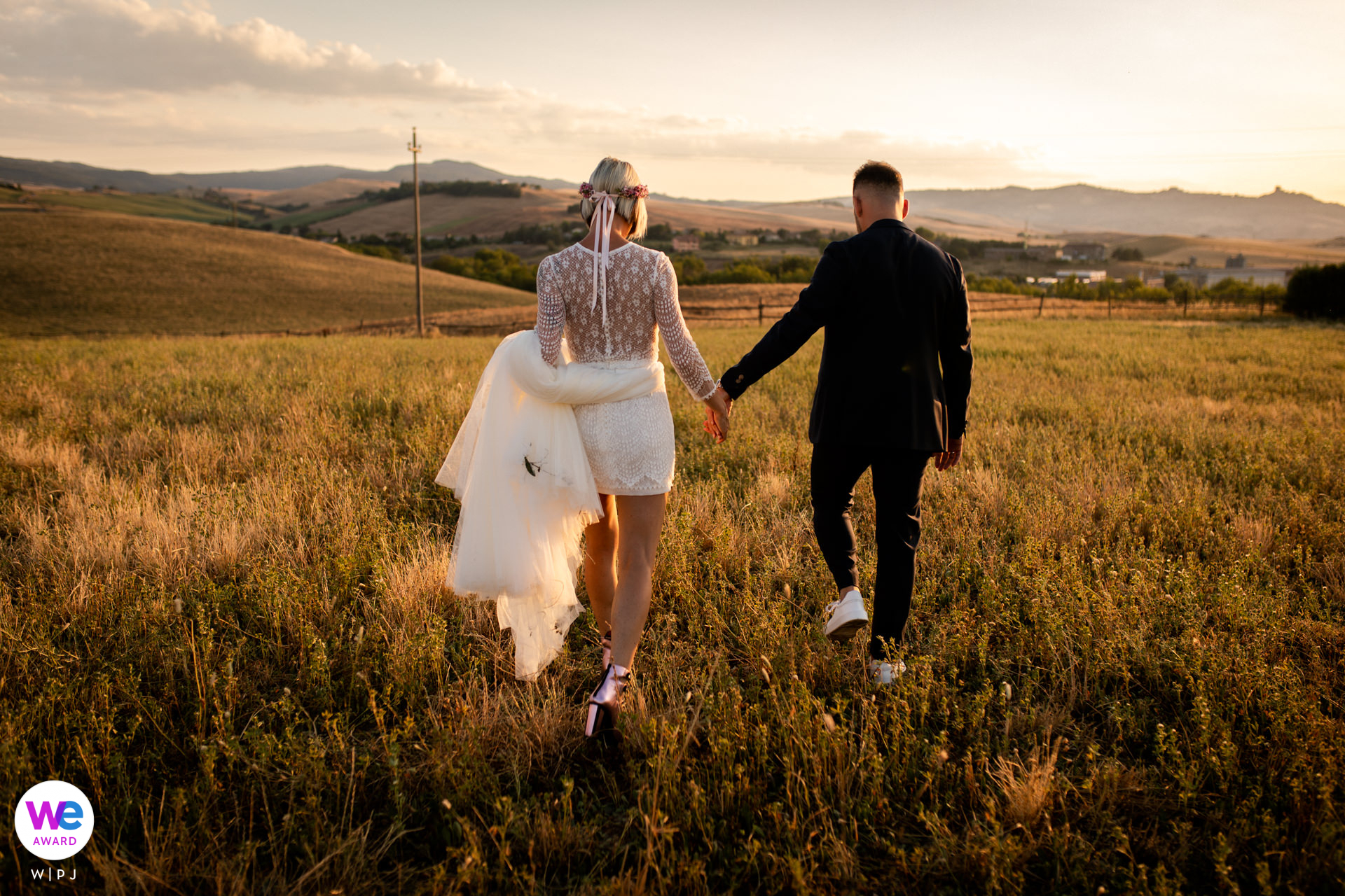 Resort Locanda Tuscany Elopement Portrait | This is a portrait of the bride and groom after the ceremony during the sunset in the countryside around the resort.