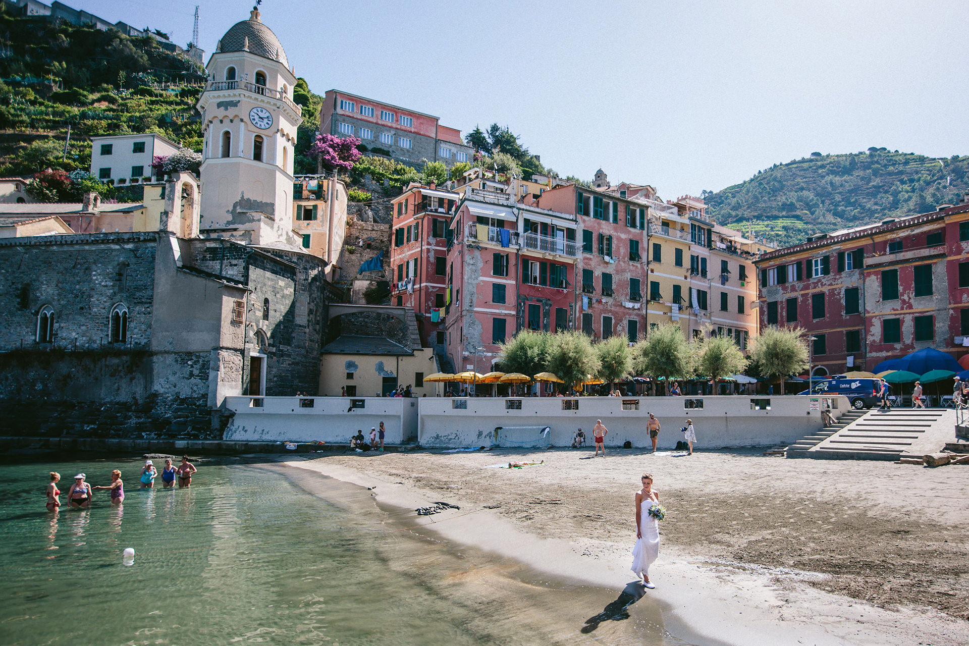 Cinque Terre - Italy Elopement Photography | The bride taking a short walk on the shoreline in Vernazza on a summer morning