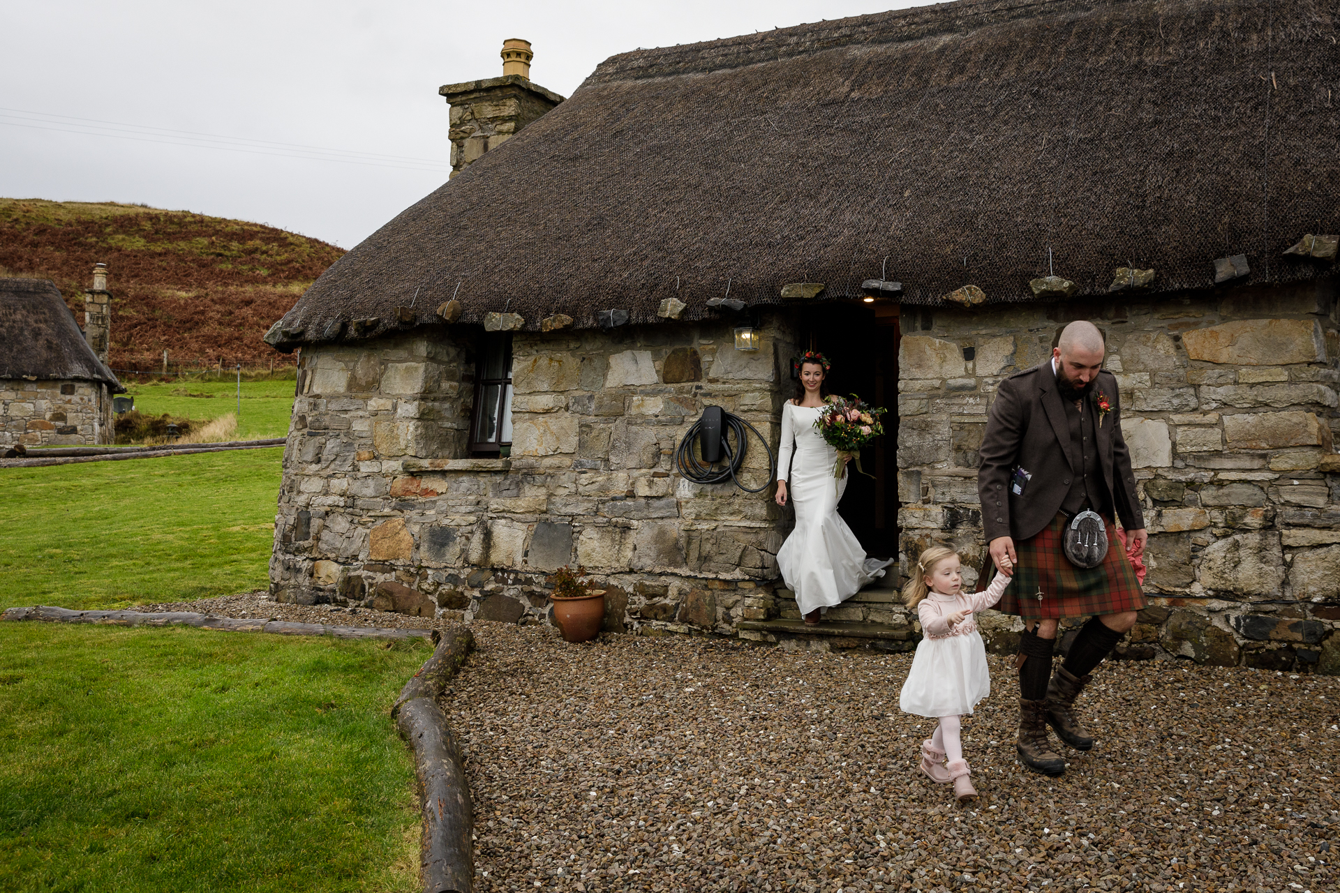 Isle of Skye, Scotland, UK Elopement Picture | A Scottish Highlands couple left their beautiful traditional Scottish stone cottage, where they had been staying, to drive down to the pier in the tiny village of Elgol