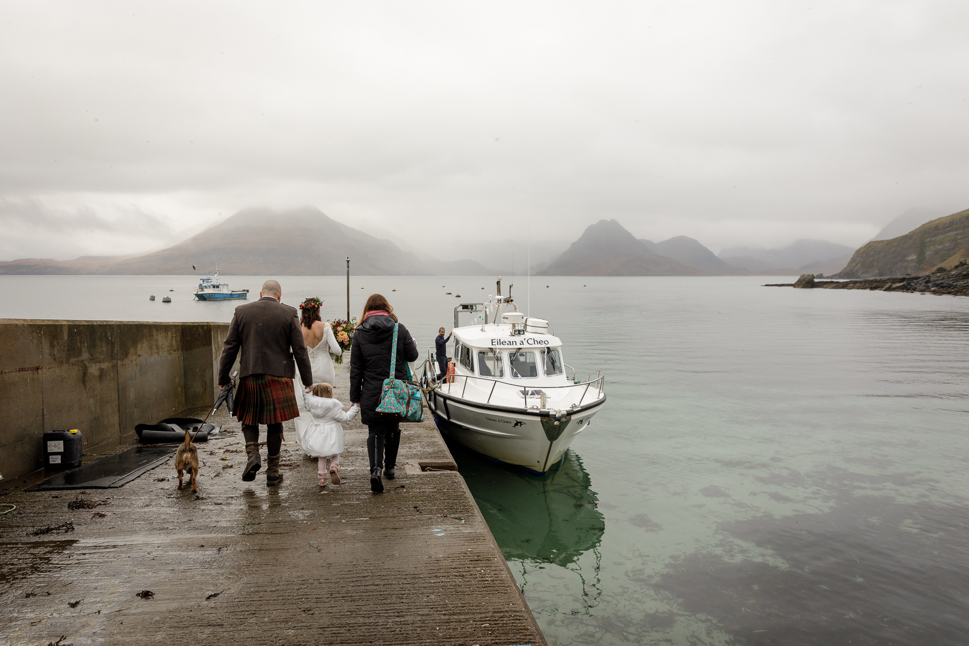 Scotland, UK Elopement Photography | The ceremony location is a magical loch nestled at the heart of the Cuillin mountain range and the only way to get there is by boat - unless you want to walk at least five miles each way.