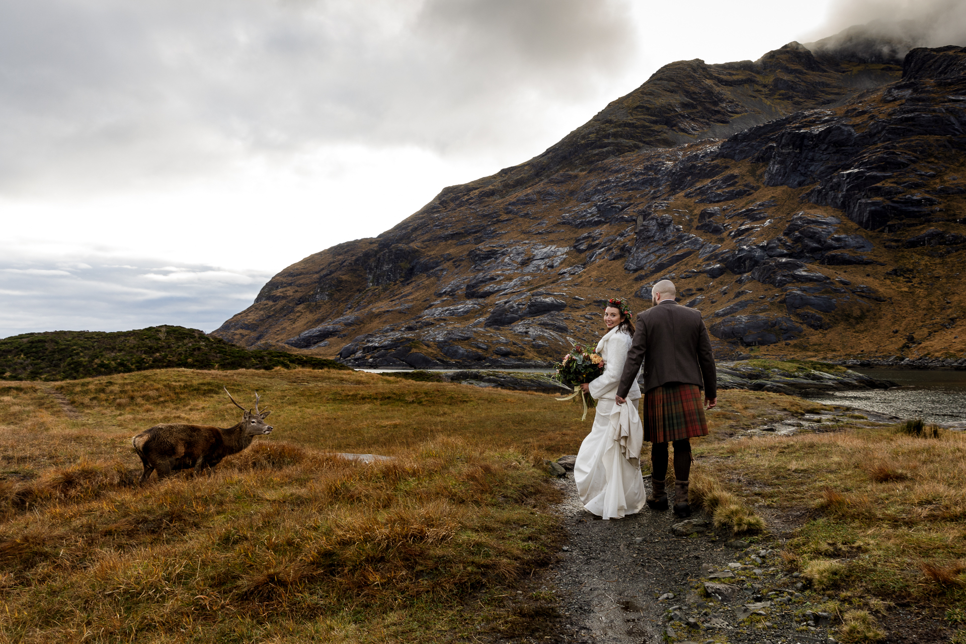 Elopement Photo at the Isle of Skye, Scotland, UK | After a bit of time spent taking some portraits of the newlyweds, we were on our way back to the boat when a beautiful stag just appeared.