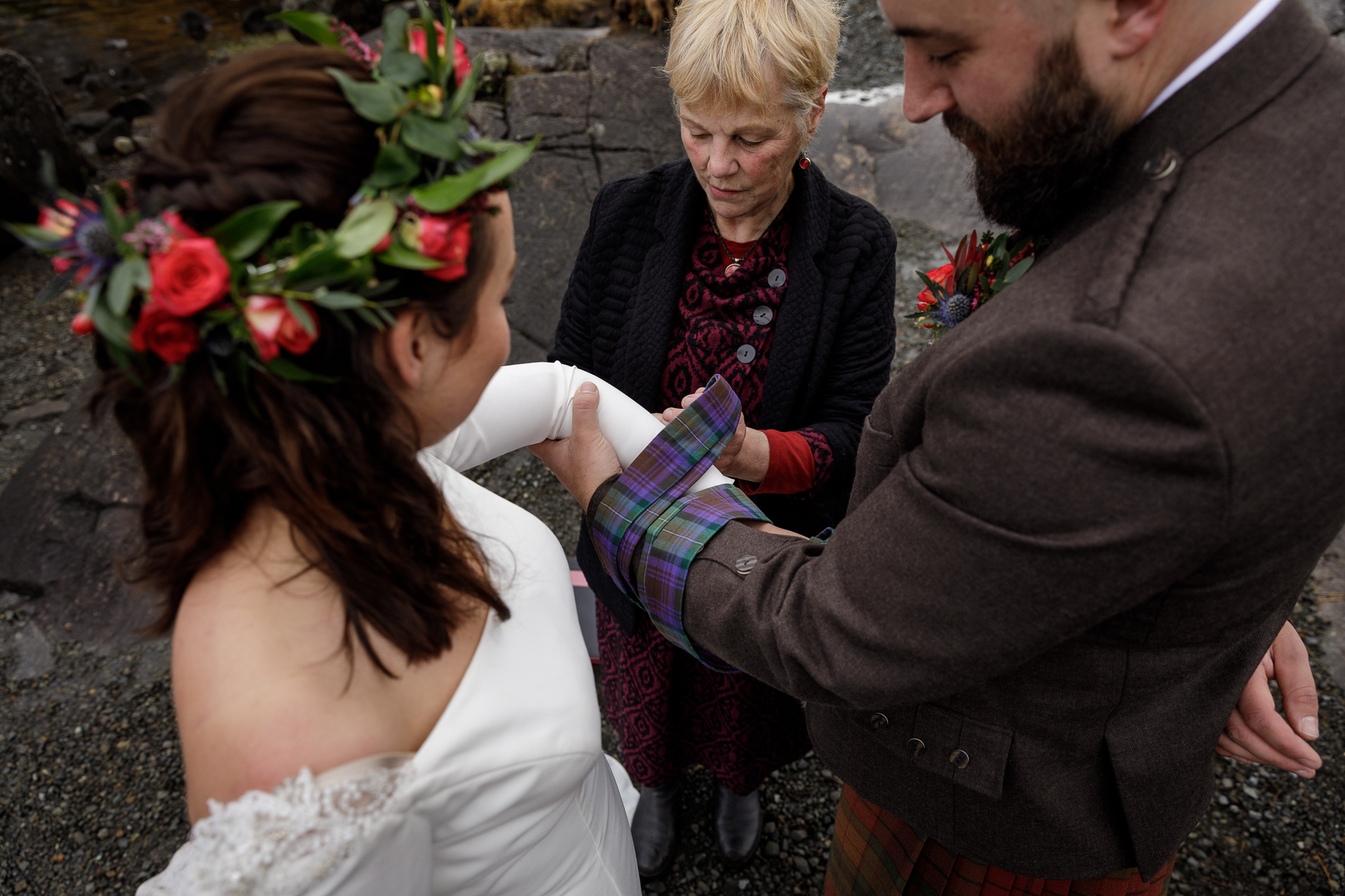 Elopement Ceremony Image from the Isle of Skye, Scotland, UK | As well as making personal vows to each other, the couple had a handfasting, which is a very ancient Celtic ritual