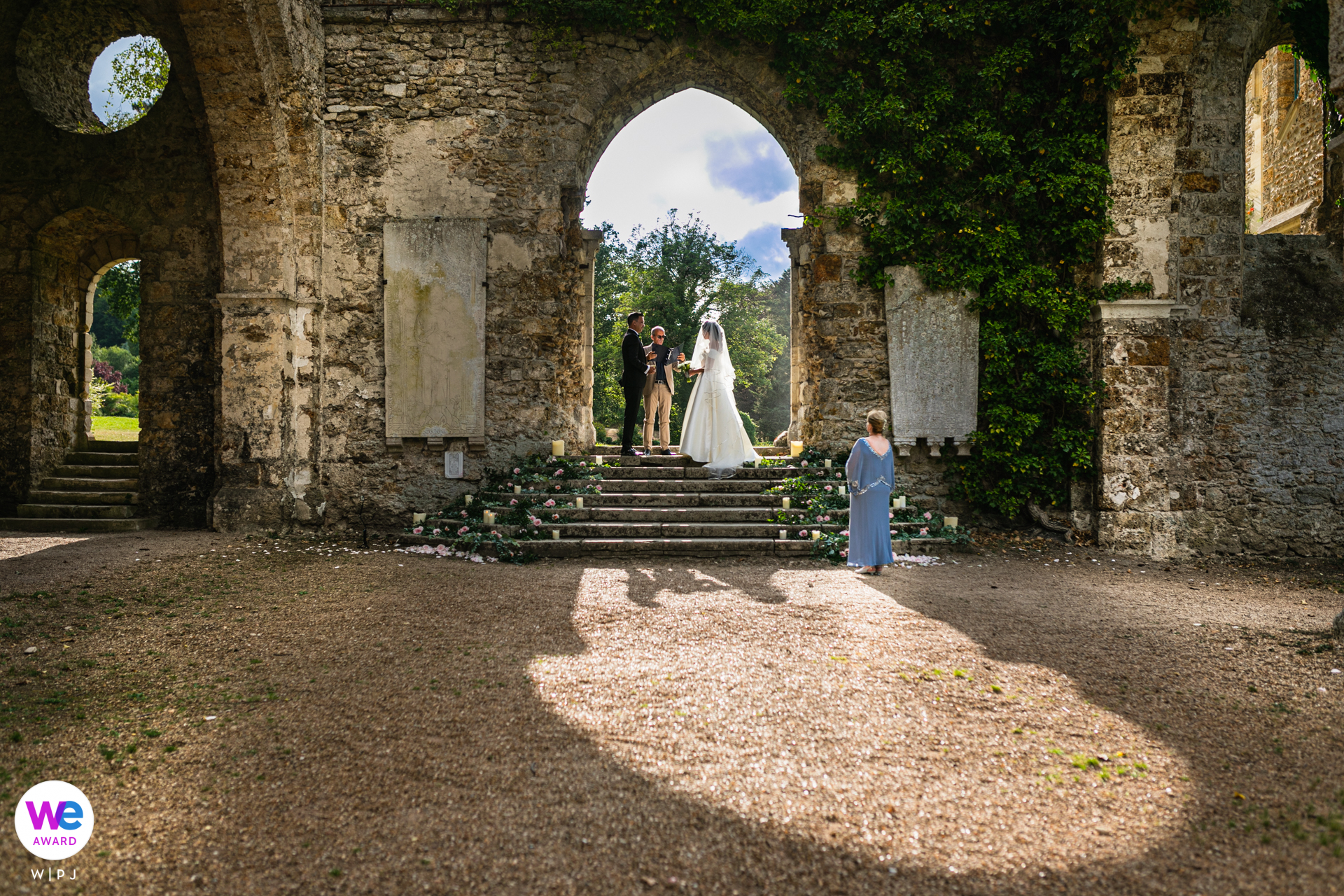 Stone Abbey in France - Elopement Photographer | They wanted to get married in France. The abbey had an incredible backdrop for their ceremony, which took place beneath a stone archway