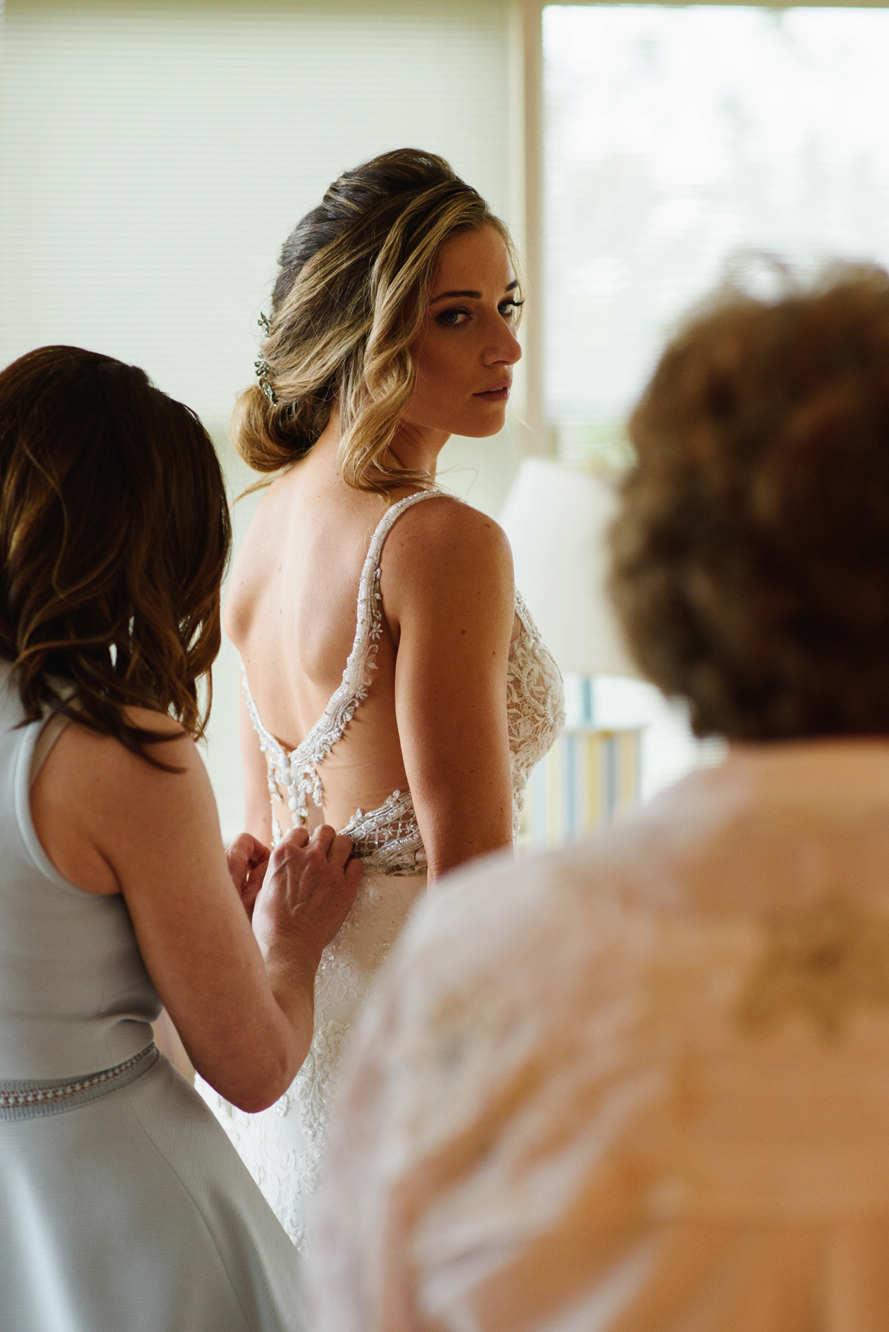 Corolla, North Carolina Elopement Bride Picture | Bride getting ready for her elopement wedding with friends and the mother of the bride