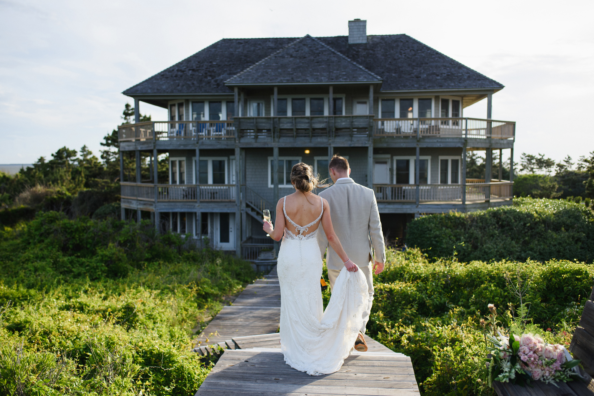 North Carolina Small Wedding Reception Picture | The bride and groom return to their small wedding reception at an oceanfront home
