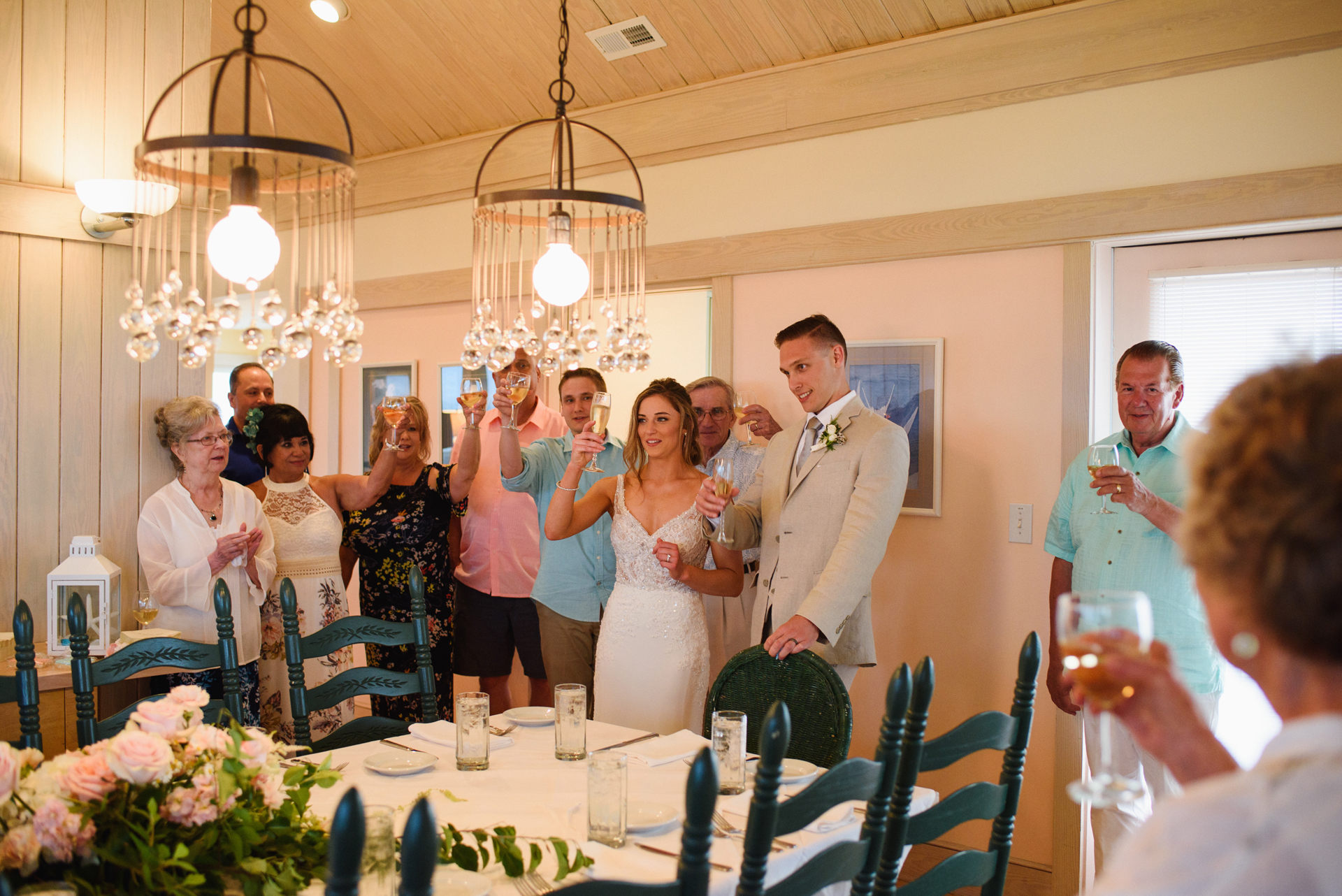 North Carolina Elopement Reception Picture | The bride and groom toast their wedding with a small group of friends and family