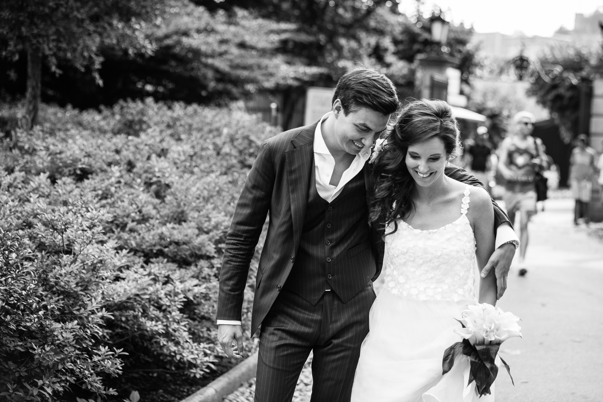 Switzerland Elopement Photography | After the ceremony, the bride and groom head outside for a walk. The groom wraps his arm around the bride's shoulder and they both smile as they go