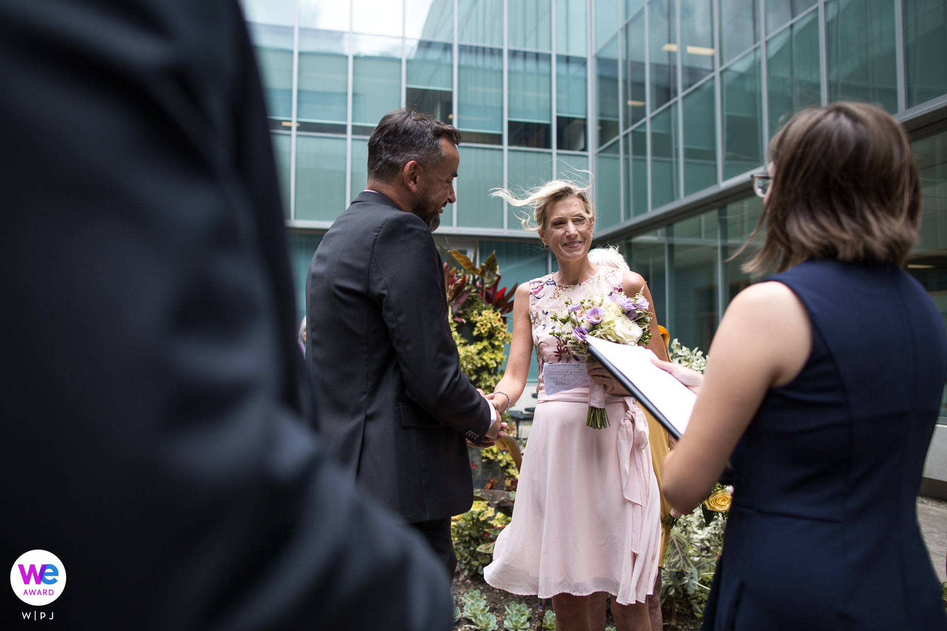 Guelph City Hall, Ontario, Canada Elopement Ceremony Photo | Outdoor ceremony took place inside the garden courtyard